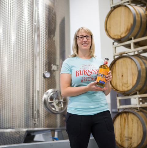 """Mel Heim is the executive vice president of operations and Eastside Distilling's master distiller. Eastside's tasting rooms are celebrating the launch of their new product with complimentary T-shirts for patrons who say """"Mel Heim sent me,"""" until Oct. 8. (Photo: Business Wire)"""