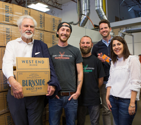 Grover Wickersham, Eastside Distilling chairman and CEO; Travis Schoney, Big Bottom Distilling lead distiller and production manager; Kyle LoGiudice, Big Bottom Distilling; Trevor Tharp graphic designer at Sandstrom; Kelly Bohls, Sandstrom Design partner/project manager all celebrating the launch of the new bourbon and new branding for Eastside Distilling. Big Bottom is a part of Eastside's distilling group. (Photo: Business Wire)