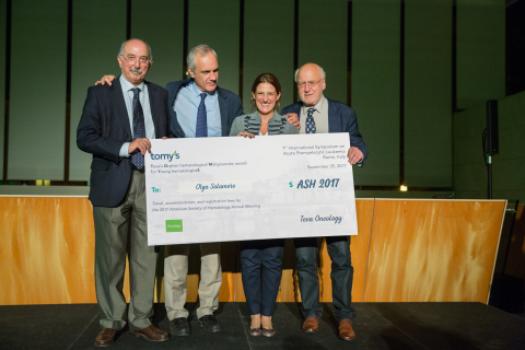 Dr. Olga Salamero receiving bursary from tomy's judging panel, Prof. Sanz, Prof. Lo Coco, and Prof. Löwenberg during the Next-Generation APL Leaders, Teva's Award for Young Hematologists in Rome, Italy (Photo: Business Wire)