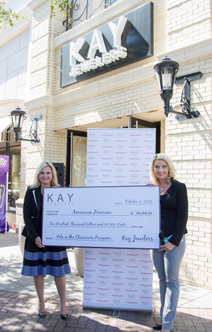 Dr. Robin Ganzert, President and CEO, American Humane, and Kimberly Kanary, Vice President, Public Relations and Social Media, Kay Jewelers, participate in a check presentation ceremony. Kay presented a $200,000 contribution in support of American Humane and its Pets in the Classroom program. Research shows that students' interaction with animals builds empathy and responsibility – both vital to creating a more humane world. (Photo: Business Wire)