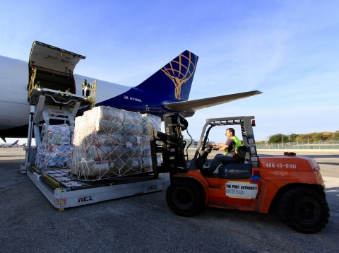 JetBlue and Atlas Air crewmembers load a 747 aircraft with more than 110 tons of supplies to assist in recovery efforts in Puerto Rico