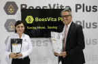 Lee Rosen (right), Chairman & CEO, Healthy Bees, LLC and (left) Francesca Del Vecchio, PhD, inventor of BeesVita Plus, scientific breakthrough in honey bee nutrition, proudly show photographers packages of advanced formulation aimed at curbing colony loss syndrome, which was prevailing topic discussed at 45th annual Apimondia International Apiculture Congress, Istanbul, Turkey. (Source: Bryan Glazer / World Satellite Television News)