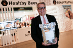 Lee Rosen, Chairman & CEO, Healthy Bees, LLC, at 45th annual Apimondia International Apiculture Congress, Istanbul, Turkey, displaying 5kg package of BeesVita Plus, his company's scientific breakthrough nutritional formulation for honey bees – billions of which face global annihilation due to unexplained epidemic of colony loss. (Source: Bryan Glazer / World Satellite Television News)