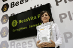 Inventor, Francesca Del Vecchio, PhD, displays 5kg container of BeesVita Plus, her scientific breakthrough for honey bee nutrition, at Healthy Bees, LLC exhibit, 45th annual Apimondia International Apiculture Congress where beekeepers and scientists discuss colony loss epidemic, Istanbul, Turkey. (Source: Bryan Glazer / World Satellite Television News)
