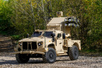 JLTV Utility equipped with Boeing Maneuever Short Range Air Defense (SHORAD) Launcher including a M3P .50 cal machine gun, M299 launcher with four Longbow Hellfire missiles, sensor suite, and a communications suite including a Thales VRC-111 (Photo: Business Wire)