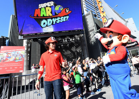 In this photo provided by Nintendo of America, fans welcome Mario at Universal CityWalk at the Super ...