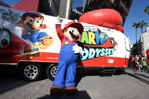 In this photo provided by Nintendo of America, Mario poses in front of his newly revealed trailer at the Super Mario Odyssey Tour Kick-off Event in Los Angeles. Over the next two weeks, Mario and his new ally, Cappy, will travel cross-country to five states to celebrate their new game, Super Mario Odyssey, which launches on Oct. 27 exclusively for the Nintendo Switch system. (Photo: Nintendo of America)