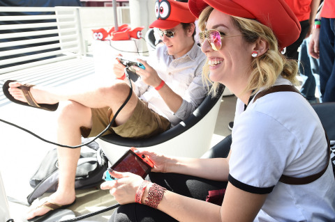 In this photo provided by Nintendo of America, YouTube personalities Meghan C. of Strawburry17 and Roger D. of RogersBase play the Super Mario Odyssey game on the Nintendo Switch system at the Super Mario Odyssey Tour Kick-off Event at Universal CityWalk in Los Angeles. Fans had the opportunity to demo the game and meet Mario at the start of his cross-country tour to celebrate his new game, Super Mario Odyssey, which launches exclusively for Nintendo Switch on Oct. 27. (Photo: Nintendo of America)