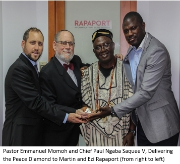 Pastor Emmanuel Momoh and Chief Paul Ngaba Saquee V, Delivering the Peace Diamond to Martin and Ezi Rapaport (from right to left) (Photo: Business Wire)