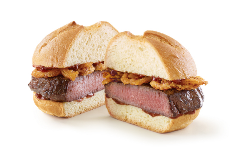Arby's Venison Sandwich features a thick-cut venison steak and crispy onions topped with a juniper berry sauce on a toasted specialty roll. The venison is marinated in garlic, salt and pepper and then sous-vide for three hours to juicy, tender perfection. The juniper berry sauce is a Cabernet steak sauce infused with juniper berries, giving the already unique sandwich another signature twist. (Photo: Business Wire)