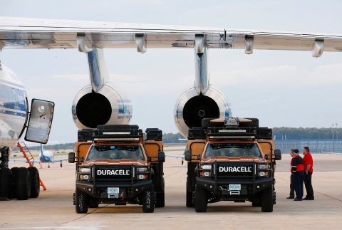 Duracell PowerForward team members load thousands of batteries into their disaster relief vehicles i ...
