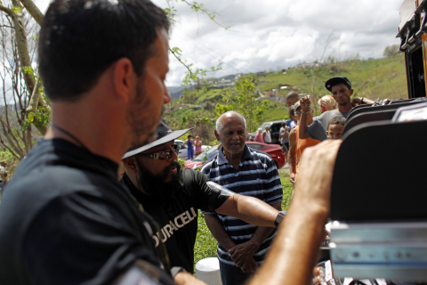 Duracell crew members distribute batteries on Friday, Oct. 13, 2017, in Naranjito, Puerto Rico. (Ricardo Arduengo/AP Images for Duracell)