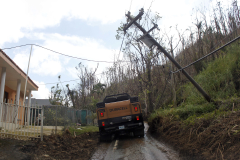 A Duracell PowerForward drives on a damaged road, Friday, Oct. 13, 2017 in Naranjito, Puerto Rico. (Ricardo Arduengo/AP Images for Duracell)