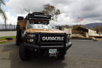 A Duracell PowerForward vehicle is seen parked in front of a destroyed house with a U.S. flag, Friday, Oct. 13, 2017 in Naranjito, Puerto Rico. (Ricardo Arduengo/AP Images for Duracell)