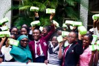 Young girls receive free sanitary pads from AHF (Photo: Business Wire)