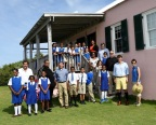 Students from the Harrington Sound Primary School visit the Trunk Island Living Classroom during a celebration of RenaissanceRe's donation to the BZS. (Pictured with the students from left to right, front row): Richard Winchell, 2nd Vice President, BZS; Wendell Ebbin, Member, RenaissanceRe Bermuda CSR Committee; Robert Qutub, Chief Financial Officer, RenaissanceRe; Adrian Hartnett-Beasley, Chairman, RenaissanceRe Bermuda CSR Committee; Dr. Jamie Bacon, BZS Education Officer; (second row, from right to left) Fikrte Ming, Teacher at Harrington Sound Primary School; Dr. Ian Walker, Principal Curator, BZS; Colin Brown, President, BZS; and (back row) Leah Dean, SVP, Human Resources and Head of Corporate Social Responsibility, RenaissanceRe. (Photo: Business Wire)