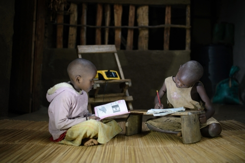 Children studying at night under light from the ReadyPay Power System (Photo: Business Wire)