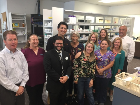 State Rep. Trumbull's staff visiting with Cooper Drugs employees in Panama City, Fla. (Photo: Business Wire)