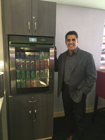 Phononic CEO Tony Atti unveils the food and beverage refrigerator installed in PNC Arena's loge boxes. (Photo: Business Wire)