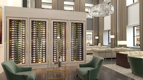 This custom refrigerated wine cabinet was handcrafted for the Ritz-Carlton, Chicago from white ash and features dual glass doors to easily access the wine from both sides of the cabinet. (Photo: Business Wire)