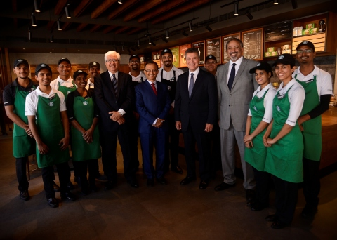 Surrounded by Tata Starbucks partners (employees), (from L-R) Ajoy Misra, chief executive officer and managing director, Tata Global Beverages; Harish Bhat, Brand Custodian, Tata Sons; John Culver, group president, Starbucks International and Channel Development; with Sumi Ghosh, chief executive officer, Tata Starbucks, celebrate the company's opening of the Victoria Mills store – the 100th store in Mumbai, India – and five-year market anniversary. (Photo: Business Wire)