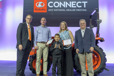 Kubota honors military veterans Matt Fitzwater (second from left), and Cherri Marin (fourth from left), with her son Ayden, with Kubota tractor donations and Geared to Give awards for their service. Pictured with Alex Woods, KTC VP of sales operations (far left) and Michael O'Gorman, FVC executive director (far right). (Photo: Business Wire)