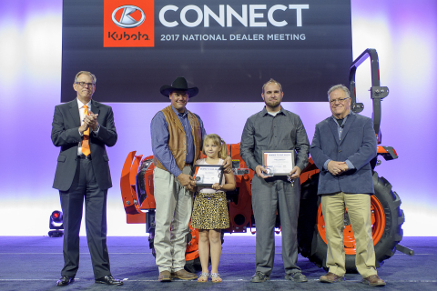 Kubota honors military veterans Joel Heinzeroth (second from left), with his daughter Emma Carol, and Randy Ramberger (fourth from left) with Kubota tractor donations and Geared to Give awards for their service. Pictured with Alex Woods, KTC VP of sales operations (far left) and Michael O'Gorman, FVC executive director (far right). (Photo: Business Wire)