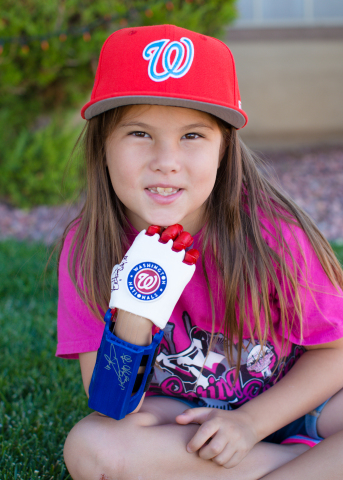 7-year-old Hailey Dawson will open Game 4 of the World Series, pitching with her 3D printed prosthetic hand, using Stratasys 3D printing technology. (Photo: Yong Dawson Photography)