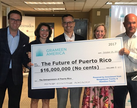 From left to right: Investor Charlie Hamilton and Kate Hamilton; David Gough CFO of Grameen America and Melissa Neugebauer and Toby Neugebauer. (Photo: Business Wire)