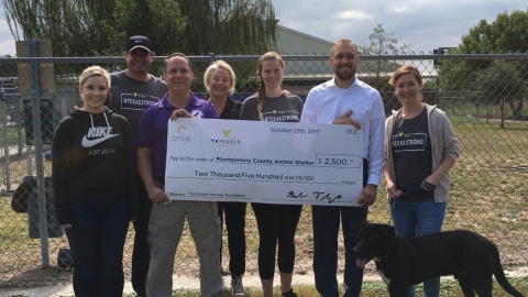 (From left to right) Kaja Aalestad and Rob Cantrell, TriEagle Energy; Mark Wysocki, Montgomery County Animal Shelter, Robin Raymond and Amanda Zent, TriEagle Energy; Aaron Johnson, Montgomery County Animal Shelter Director; and Chelsea Erdmann, TriEagle Energy, present a portion of the $30,000 in Hurricane Harvey relief funds raised through an internal donation drive by TriEagle and Crius Energy. (Photo: Business Wire)