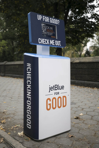 During JetBlue For Good Month, the airline is asking customers to #CheckInForGood at kiosks in New York and Los Angeles and enter to win a complimentary trip to volunteer with some of the airline's non-profit partners. (Photo: Business Wire)