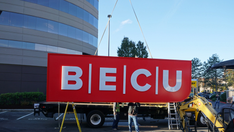 Unveiled today, BECU installs its new logo on the Tukwila Financial Center headquarters. (Photo: Business Wire)