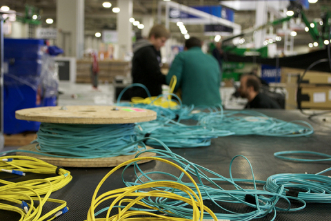 Beck and Miller tested 84 reels of used fiber, like this one from SC16, to determine what can be reused in Denver's Colorado Convention Center for SC17. The duo has been able to refurbish 24 of those reels, which amounts to 1.28 miles of fiber. (Photo: Business Wire)