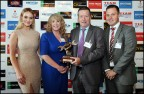 From left to right: Kellie McGrath, model; Martina Campion, Enterprise Rent-A-Car; David Dempsey, Vehicle Refinish Sales Manager Crown Paints Ireland, accepting the award on behalf of Spies Hecker; and JP Denker, Enterprise Rent-A-Car (Photo: Axalta)