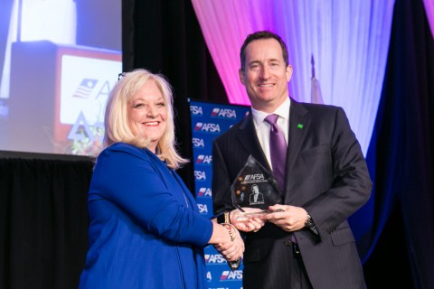 AFSA Chair Ginger Herring (left) presents the Distinguished Service Award to Andrew Stuart (Photo: Business Wire)