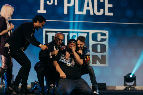 Comedian Chris Hardwick (right) and actor Darin De Paul, voice of Reinhardt in Blizzard Entertainment's Overwatch, embrace Jay the Tavern Bard, winner of the BlizzCon 2017 talent contest, during the Community Night celebration on Friday, November 3. (Photo: Business Wire)
