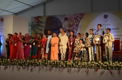 Hon'ble CM, Uttar Pradesh, Shri Yogi Adityanath Ji at the HCL Samuday unveiling ceremony along with Mr. Shiv Nadar, Founder & Chairman, HCL & Shiv Nadar Foundation; Roshni Nadar Malhotra, CEO, HCL Corporation; Dy CM, Uttar Pradesh, Dr. Dinesh Sharma; State Minister IT & Electronics, Mohsin Raza and Navpreet Kaur, Director, HCL Samuday and some of the Samuday beneficiaries (Photo: Business Wire)