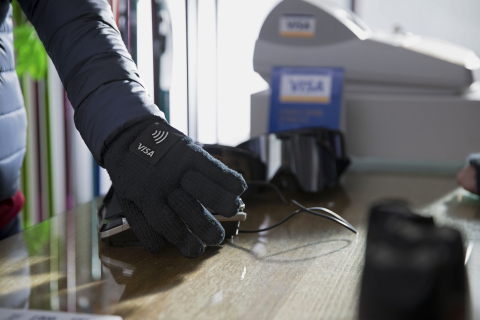 Visa, the exclusive payment technology partner of the Olympic and Paralympic Games, today introduced three commercially available wearable payment devices: NFC-enabled payment gloves, commemorative stickers and Olympic pins. Pictured here: the Visa payment-enabled gloves. (Photo: Business Wire)