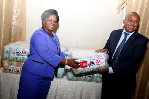 First Lady of Zambia (Madam Esther Lungu) receives Sanitary pads from Dr. Mabvuto Kango (Country Pro ...