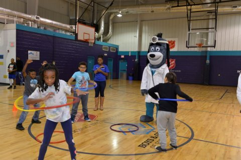 """Members of the Boys & Girls Clubs of Greater Charlotte were led through exercises with UnitedHealthcare mascot Dr. Health E. Hound to test their new NERF ENERGY Game Kit that tracks activity earning """"energy points"""" in order to play the game. Today's donation of 150 kits is part of a national initiative between Hasbro and UnitedHealthcare, featuring Hasbro's NERF products, that encourages young people to become more active through """"exergaming"""" (Photo: Pam Brackett)."""