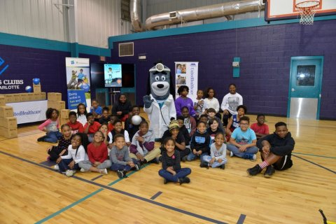 """UnitedHealthcare donated 150 NERF Energy Game Kits to the Boys & Girls Clubs of Greater Charlotte as part of a national initiative to encourage young people to become more active through """"exergaming."""" Martha Browne of UnitedHealthcare helped mascot Dr. Health E. Hound demonstrate the NERF ENERGY Rush app to Club members. The donation is part of a recently launched national initiative between Hasbro and UnitedHealthcare, featuring Hasbro's NERF products, that encourages young people to become more active through """"exergaming"""" (Photo: Pam Brackett)."""