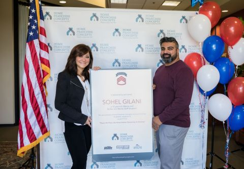 "Home Franchise Concepts (HFC) of Orange, Calif., awards a $300,000 small business package to a deserving Charlotte, N.C., veteran on Veterans Day as the fulfillment of its year-long ""There's No Place Like Home Veteran Giveaway. From left is Shirin Behzadi, HFC CEO, and Sohel Gilani, a 15-year U.S. Marine Corps veteran. (Photo: Business Wire)"