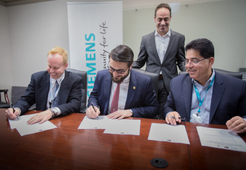 Siemens recently signed a Memorandum of Understanding (MOU) with Bayat Power and the Government of the Islamic Republic of Afghanistan to provide its SGT-A45 mobile gas turbine which will form the foundation of a three-phase energy project in Afghanistan. Left to right: Monty Simus, Vice President, Business Development, Bayat Power; Honorable Dr. Hamdullah Mohib, Afghanistan Ambassador to the United States; Thomas Scarinci, Head of Product Management, Siemens Power & Gas, and Martin Tartibi, Global Head, SGT-A45 Mobile Unit, Siemens Power & Gas. (Photo: Business Wire)