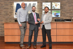 Harrison Dorne, Regional Account Manager for CU Realty Services LLC (center), presents the award to Joe Talmadge, Northwest Federal's Vice President of Mortgage Lending (left) and Nestor Villanueva, Northwest Federal's Mortgage Operations Manager (right) (Photo: Business Wire)