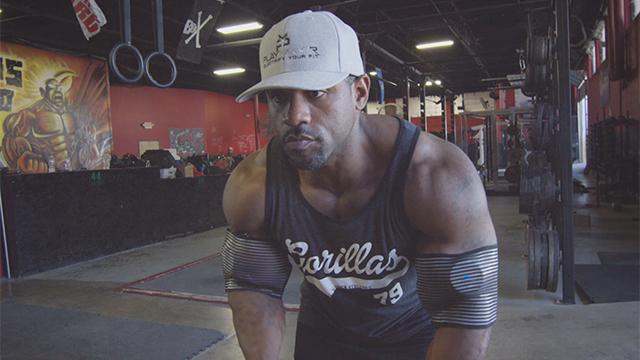 Bodybuilder discussing benefits