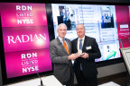 Radian CEO Rick Thornberry is presented with a medal by NYSE Client Services Manager Jim Byrne to celebrate 25 years of trading. (Photo: Business Wire)