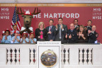 The Hartford's Chairman and CEO Christopher Swift rang The Closing Bell® at the New York Stock Exchange (NYSE) on Nov. 16. Joining Swift from The Hartford was Chief Financial Officer Beth Bombara and Chief Marketing and Communications Officer Kathy Bromage. In addition, FDNY Lieutenants Michael Kozo, John Errico, and Steven Vano, Firefighter Frank Vanderlofske and six students in kindergarten through third grade from P.S. 63 in the Bronx also joined Swift on the platform to raise awareness of the importance of fire safety. (Photo: Business Wire)
