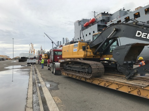 Heavy equipment is offloaded from the USNS Brittin in Puerto Rico to help with ongoing power restora ...
