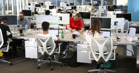 The 1QBit team at work (Photo: Business Wire)
