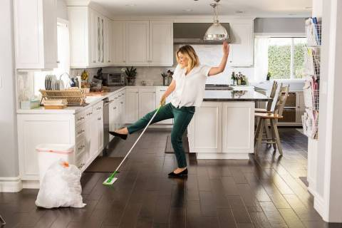 Actress and comedian Abby Elliott busts a move with her Swiffer Sweeper in the kitchen while filming ...